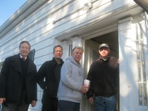 Bill Primavera, Jean-Francois de Laperouse, Councilman Nick Bianco and Yorktown Historical Society President Paul Martin outside of the Federal-style doorway.