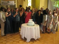 """Honorees and ceremony participants sing """"Happy Birthday"""" to Girl Scouts."""