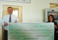 Richard and Donna D'Andrea present The Greater Mahopac-Carmel Chamber of Commerce a check.