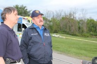Yorktown Police Chief Daniel McMahon (right) with a representative of the Westchester Police Department on the scene of the plane crash in Yorktown.