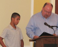 Joshua Nelson (left) was cited for his bravery by Southeast Councilman Robert Cullen (right).