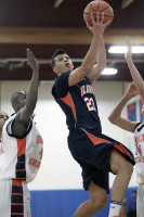 Briarcliff's Jared Jones sails to the basket in Friday's win by the Bears over Greeley. Photo by Andy Jacobs