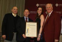 Westchester County Executive Robert Astorino (second left) presented a Proclamation to former Fordham Athletic Director Frank McLaughlin (right), a Braircliff resident and Certificates of Merit to Eastchester native Michael Debany (left) and Michelle Maguire Kennedy from Tarrytown, on their induction into the Fordham University Athletic Hall of Fame. Photo by Albert Coqueran