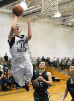 Putnam Valley junior G Zach Coleman goes above the rim to dazzle a pair of Pleasantville defenders with a choice alley-oop hoop, part of a 14-2 fourth-quarter run in the Tigers' come-from-behind 41-38 win over the visiting Panthers last Wednesday.. Photo by Ray Gallagher