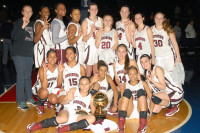 Members of the Ossining girls basketball team pose with their third consecutive gold ball Sunday at the Westchester County Center.