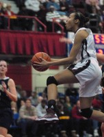 Ossining G Saniya Chong soars to rack for two of her 39 points in the Pride's 83-51 Section 1 Class AA title-clinching win over Lourdes to complete the three-peat last Sunday at the Westchester County Center.