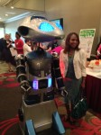 Millennia the robot, was very social during the networking portion of Friday's YWCA event. She was seen chatting with almost every one of the 500 attendees. Next year she might be seen wearing  YWCA's Persimmon.