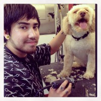 Daniel Garrido of Glam Star Grooming with a happy spa customer.