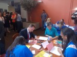 County Executive Rob Astorino and Alisa Kesten, executive director of The Volunteer Center of United Way, join students to write letters to soldiers.