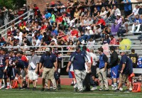 Stepinac Head Coach Mike O'Donnell (center) and his staff control the strategy from the sideline, as the Crusaders faithful enjoy their Home Opener win over Mount St. Michael, 47-14, on Saturday, September 7, at Stepinac High School. Photo by Albert Coqueran