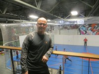 Aresh Mohit runs Fenom Fitness in Harrison. The large mural in the photograph includes graffiti by an Argentinian artist.
