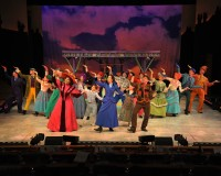 "The cast of 'Mary Poppins' on stage at Westchester Broadway Theater performing ""Anything Can Happen"" from the musical's second act."