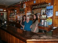 Photo caption: Joanie Mitchell (center), her daughter Janine (left) and one of their long time employees Brenda Heady all hope the Spruce Hill Inn can overcome tough times and stay open past July. Mitchell, a long time Putnam Valley resident, has owned the bar for 23 years.  DAVID PROPPER PHOTO