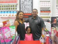 Photo caption: Ricky and Yasmin Jaisingh opened a GNC store in the Cortlandt Town Center in May. Also shown is their daughter, Malia. Photo credit: Neal Rentz