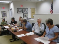 The Southeast Town Board and the Brewster Village Board of Trustees held a combined public hearing on June 18 in village hall on a proposal for a four-story office building.