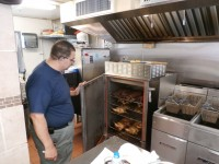Owner Bob Soto shows off the variety of meats customers can choose from when they stop by.
