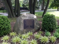 """A plague from the White Plains Historical Society at the Meditation Garden outside the Chapel of the Divine Compassion reads: """"The Good Counsel Complex listed on the State Register of Historic Places, January 14, 1997 and the National register of Historic Places, April 25, 1997 in recognition of its Significance in American History and Culture. Eleven buildings stand as a monument to the vision, inspiration and commitment of Mother Mary Veronica, an outstanding 19th century religious leader. Foundress of the Sisters of the Divine Compassion and designer of the Chapel, Convent and High School buildings on this site…"""""""