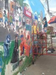 Artist Puts Finishing Touches on Chappaqua Book Festival Mural