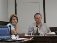 Chairman Carl Albano and Legislator Barbara Scuccimarra both sit at a Physical Services Committee meeting where the start time of a joint meeting between the legislature and the Philipstown and Cold Spring Boards was argued for 20 minutes.