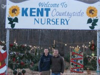 Brothers Fred And Joe Kussin Stand Under The Sign Of Kent Countryside Nursery Along Route