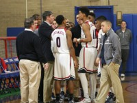 Second-year Stepinac Head Basketball Coach Steve Herman speaks to his team, as he tries to rally his squad against Cardinal Hayes. Nonetheless, the Crusaders lost their fourth straight game, while losing to the Cardinals, 85-70.