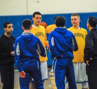 Mahopac and Carmel captains meet with officials before their ballyhooed game on January 23rd, which went off without a hint of bad blood or unsportsmanlike behavior.