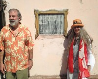 """Dan Stoddard and Milagros Lecuona in Cuba. The sign reads in Spanish that """"In this house lived Ernesto Lecuona Y Casado."""""""