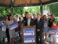 Bedford Councilman Francis Corcoran, surrounded by his supporters, including Westchester County Executive Rob Astorino, announced his candidacy Thursday in Katonah for the county Board of Legislators District 2 seat on June 25.