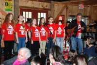 The Music Cottage students, alongside George Krzyzewski, performing at Daryl's House in Pawling. PROVIDED PHOTO