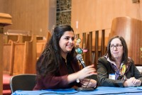 Sana Mustafa, a Syrian activist, who came to the United States in 2013, described her family's struggle since the Syrian Civil War broke out in 2011 at a forum on the Syrian refugee crisis in White Plains earlier this month. Rev. Doris Dalton is pictured at her right. Photo courtesy of Andrew Courtney