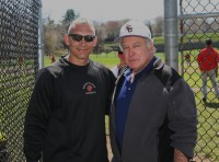 White Plains Head Coach Marcel Galligani (left) greets tournament namesake Joe McAvoy, before the start of the 13th Annual Joe McAvoy City Challenge, which pits City of White Plains rivals Tigers versus Crusaders on the diamond, at White Plains High School. Albert Coqueran Photos