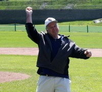 : Joe McAvoy, who was the Head Baseball Coach at WPHS for two intervals totaling 19 years, throws out the ceremonial first pitch to commence the Joe McAvoy City Challenge, at White Plains High School, on Saturday.