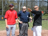 Stepinac Head Coach Keith Richardson (left), umpire Dan Campbell (center) and White Plains Head Coach Marcel Galligani go over the ground rules before the start of the 13th Annual Joe McAvoy City Challenge.