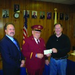 Past Chief and Senior Trustee Andrew Cody (center) of Buchanan Engine Company No. 1 presents donation check to Jerry Underwood, co-chair of the fundraising committee, while Buchanan Mayor Sean Murray looks on.
