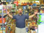 Al Cardullo is pictured down one of the aisles of Beverage World, which is filled with beers from both near and far.