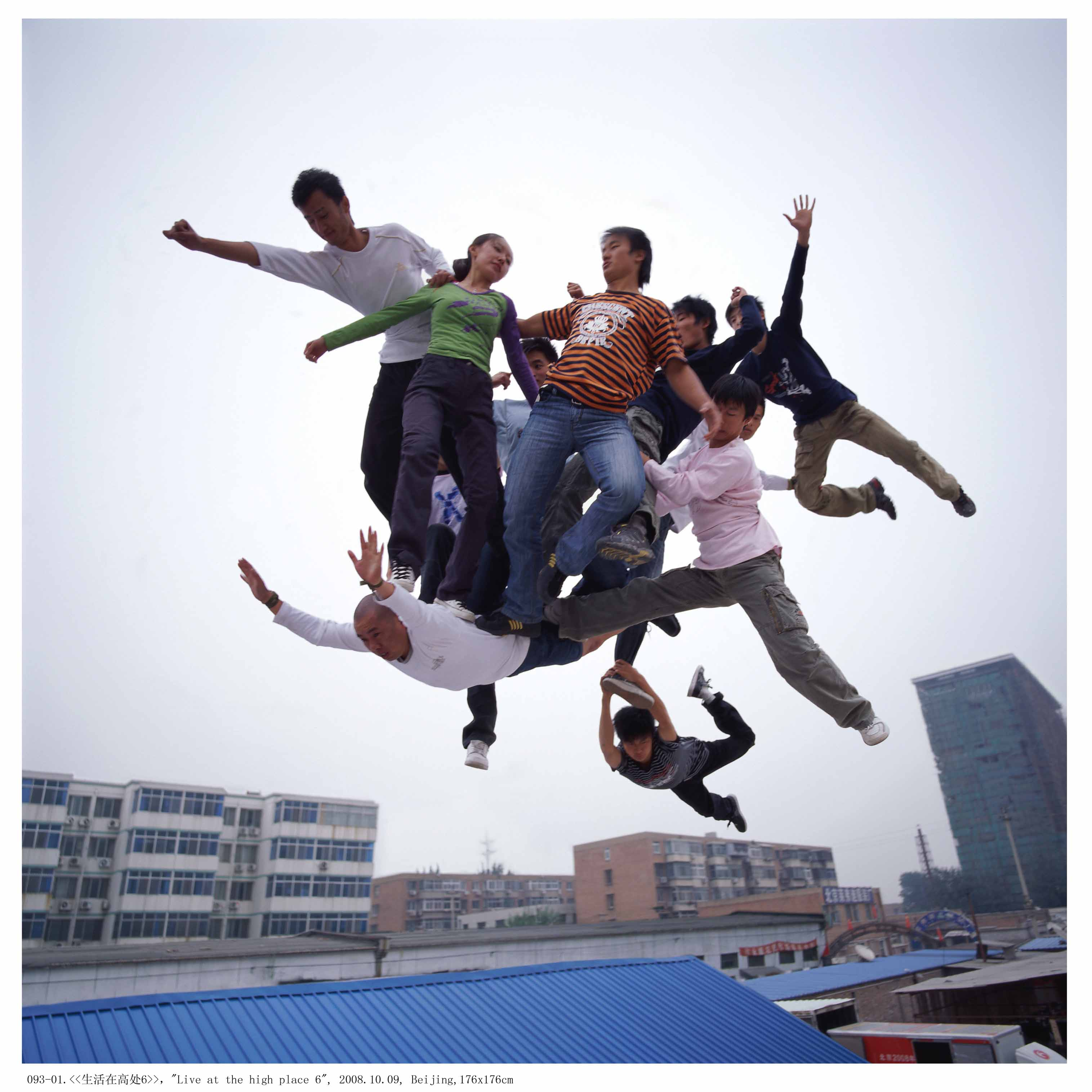 """Le Wei's photograph of a group skydiving--without parachutes, a work from one of more than 30 Chinese photographers on display in the """"Rising Dragon: Contemporary Chinese Photography"""" exhibit, now through Sept. 2 at the Katonah Museum of Art."""
