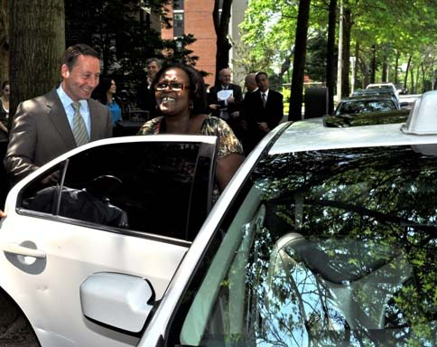 County Executive Rob Astorino helps ParaTransit rider Robin Jones, a White Plains resident, into a taxi on Tuesday, May 29.