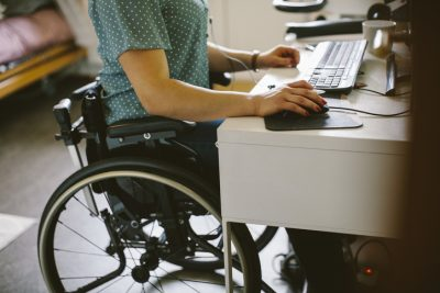 Person in wheelchair using the computer