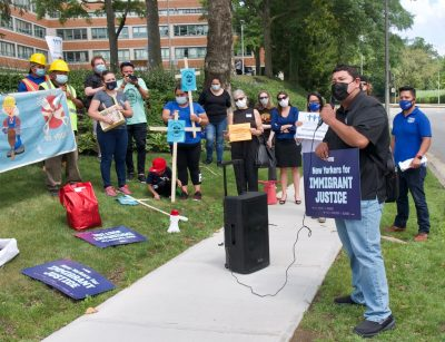 Fund Excluded Workers Coalition at rally
